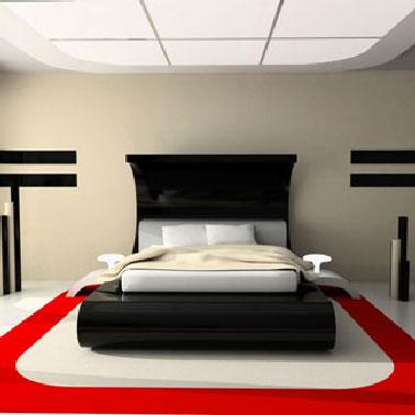 Pour personnaliser le sol de cette chambre design, un tapis est peint directement sur le sol avec une peinture spéciale sol dans un jeu de couleur rouge et blanc cassé autour du lit.