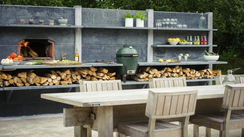 Barbecue sur terrasse en pierres for Idee amenagement de jardin exterieur