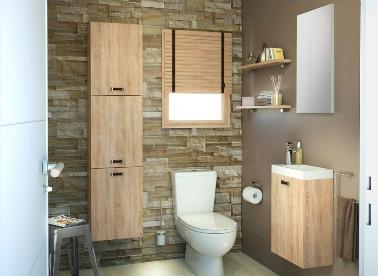 Des matériaux naturels pour amener de la chaleur. Voilà le parti pris de ces WC. Un mur en pierre apparente et les meubles en bois réchauffent l'atmosphère de cette pièce d'habitude froide et austère. Une déco naturelle relevée par un mur taupe.