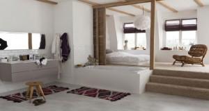 Une idée à retenir pour concevoir le plan d'une suite parentale : aménager la chambre en mezzanine et l'espace salle de bain ouvert en contre bas face à l'entrée de la chambre