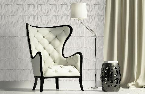 Joli effet matière sur les murs du salon avec un papier peint en trompe l'oeil imitation briques blanche