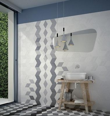 Un carrelage à motifs graphiques, une bonne idée pour relooker sa salle de bain. Des couleurs sobres et trompe l'oeil suffisent à rendre la pièce unique !