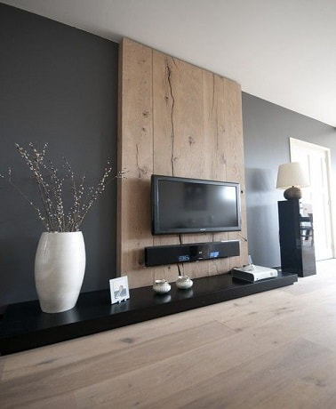 du gris anthracite et du bois sur le mur dans un salon. Black Bedroom Furniture Sets. Home Design Ideas