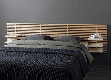 Cette tête de lit en bois charmante n'est pas qu'esthétique. Elle est aussi fonctionnelle grâce à ses tablettes amovibles. Une idée originale pour sublimer son lit !