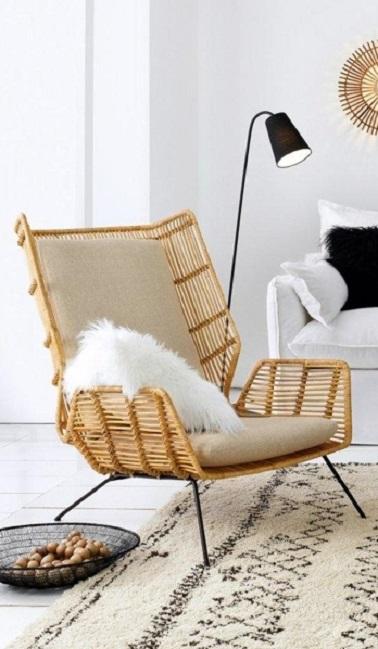 Le rotin continue à décorer les salons comme avec ce fauteuil La Redoute. Dans un style très naturel et moins vintage, ce fauteuil apporte de la douceur à l'intérieur.