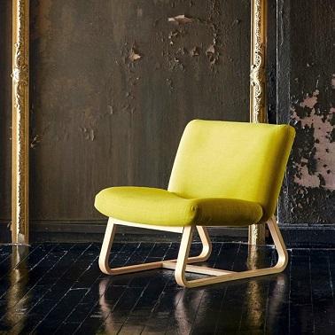 Le fauteuil La Redoute tendance de cette année ose la couleur. Flashy, il n'hésite pas à se jouer du jaune et de sa gaieté pour sublimer sa forme. Un style charmant !