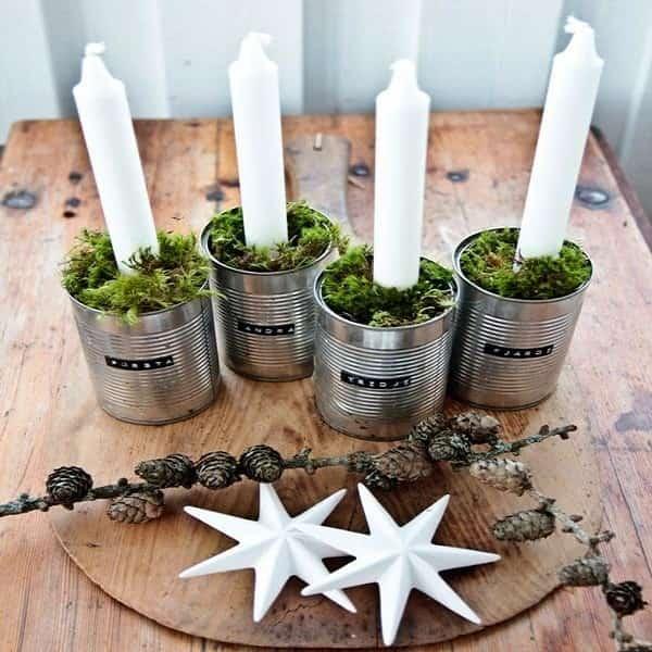 Des boites de conserve recyclées en bougeoirs originaux pour Noël.