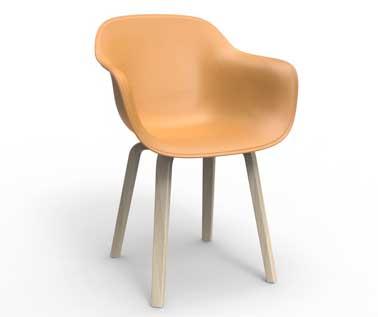 Douceurs des lignes, élégance des matière en bois et en cuir sur ce petit fauteuil orange de créateur. Vue dans la nouvelle collection Magis. Modèle Substance design Naoto Fukasawa.