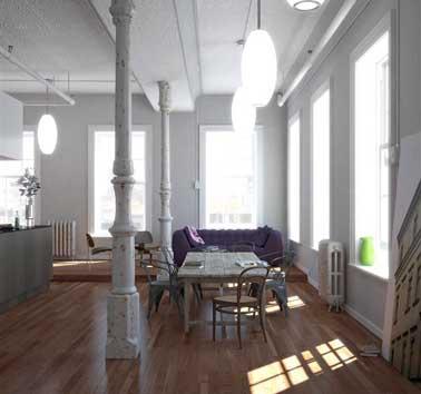 Peinture gris perle lumineuse sur murs et boiseries de ce salon indus avec canapé violet. Belle harmonie avec l'îlot de cuisine, la table de salon et les boiseries grises