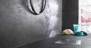 Relookersasalle de bainavec dubéton minéral et l'effet déco est immédiat ! Un béton ciré sous forme d'enduit parfait dans une douche italienne, sur les murs et le sol en carrelage ou brut
