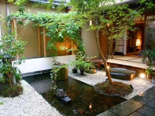 Comment am nager un jardin zen deco cool for Decoration jardin avec fontaine