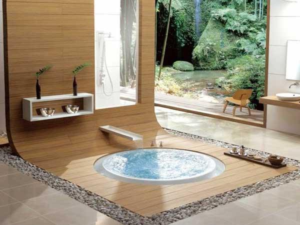 Mix bois et parterre galet pour le jacuzzi de cette salle de bain zen combiné avec une douche