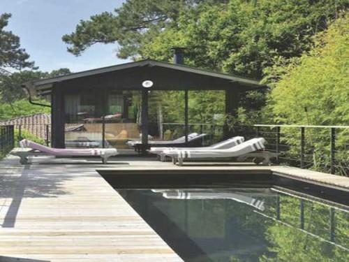 jardin zen avec piscine d exterieur et terasse en bois. Black Bedroom Furniture Sets. Home Design Ideas