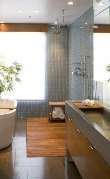 Refaire une salle de bain dans l'esprit zen est facile avec quelques éléments typiques de ce style : le bois, et un bambou en pot. Il n'en faut pas beaucoup plus pour une déco asiatique.